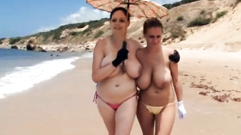 beach big boob topples