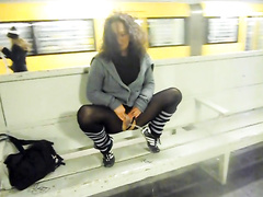 German girlfriend in pantyhose pees at a public train station