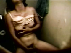 Moaning Asian amateur masturbates in restroom