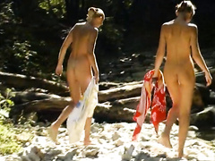 Nude teen beauties splash in the river