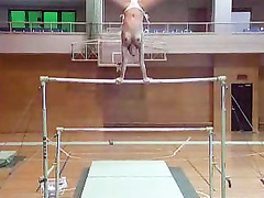 Female gymnast does her routine in bikini bottoms