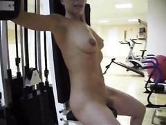 Naked spouse works out in the gym as I film