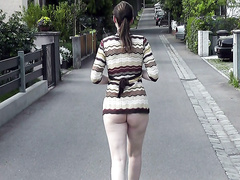 Sweater girl with a big ass strolls half naked outdoors