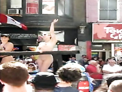 Undressed girl with small tits on a parade float