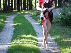 Shaved pussy upskirt walking down a wooded path