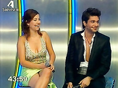 Cleavage and upskirt tease with cute TV host