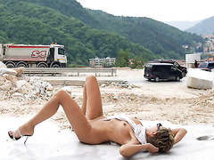 Naked lady in high heels walks the construction site