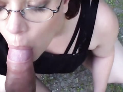 Chick with glasses sucking a dick on the street