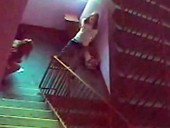 College girls piss on the stairs in security cam footage