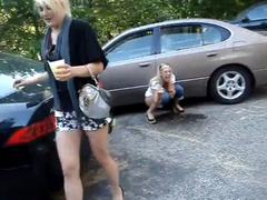 Laughing blonde girlfriend pees in the parking lot