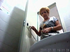 Old lady urinates in hidden camera video clip