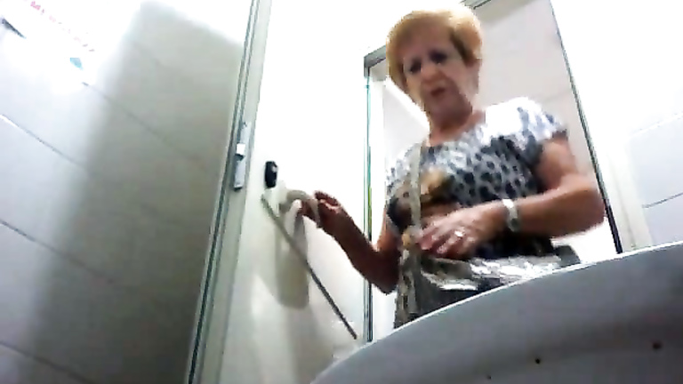 Old lady urinates in hidden camera video clip