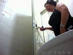 Old lady with a big ass goes pee in public toilet