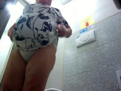 Fat old lady brings her own wipes for the toilet
