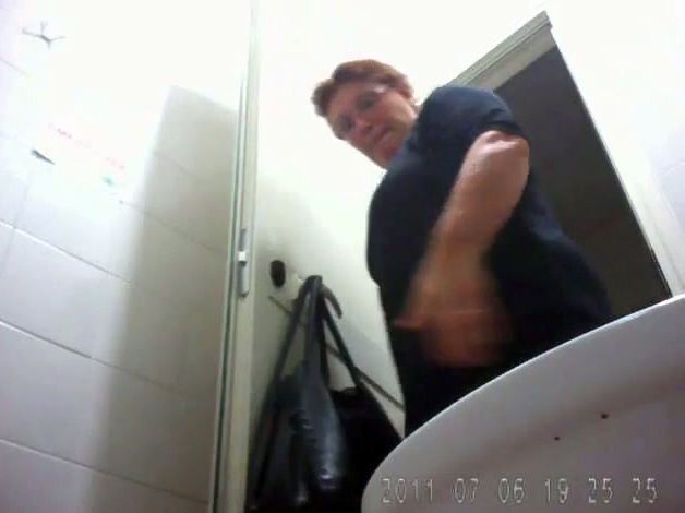 Mature toilet spy