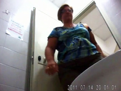 Huge ass woman goes pee in public WC