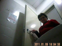 Granny peeing in public toilet on hidden camera movie