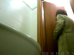 Mature in skirt and stockings pissing over public toilet