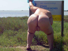 BBW blonde pissing by the side of the road