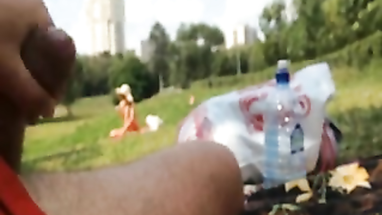 Stroking my dick to a bikini girl in the park