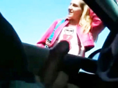 Street hooker reaches into the car and gives a handjob