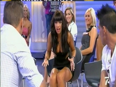 Busty babe on reality show gives upskirt flashes