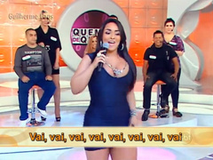 Chubby Latina in a tight dress sings on TV show