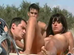 Man masturbates to a hot couple on the beach