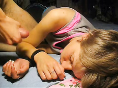 Giving a sleeping girl a messy facial cumshot