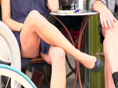 Beautiful girl with crossed legs at a restaurant