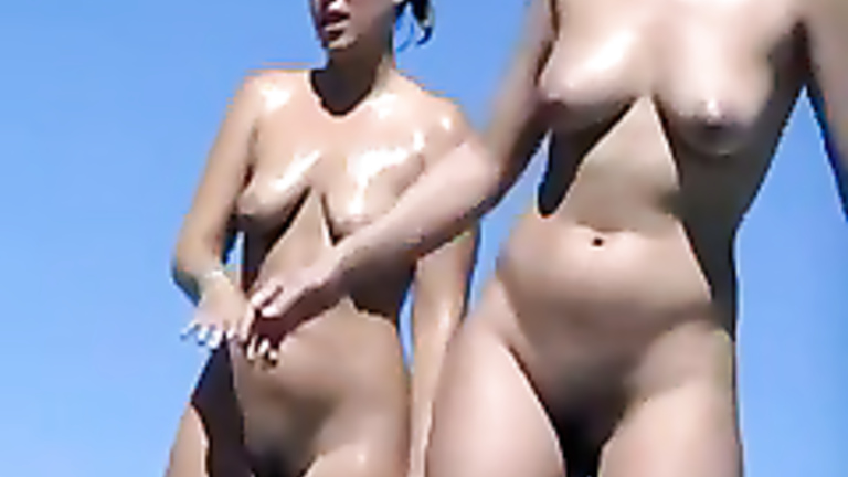 Curvy naked chicks are sweaty at the beach