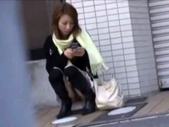 Japanese girl sexy upskirt on public sidewalk