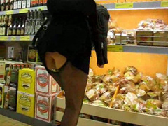 Grocery store upskirt with girl in boots