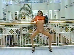 Milf in the mall flashes tits and pussy