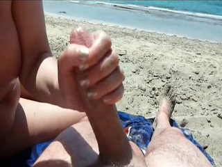 Private beach handjob