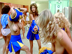 College cheerleaders get dressed in locker room