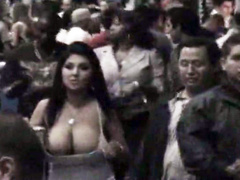 Giant boobs spill out of a top in public
