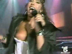 Italian popstar sings and her big tit pops out