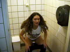 Brunette pees on camera and wipes her pussy