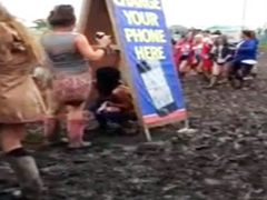 Hippie girl peeing in the mud at concert