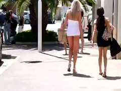 Charming lady in short dress shows her ass on the street