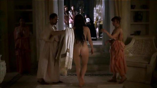 Nude redhead lady in a Roman bath