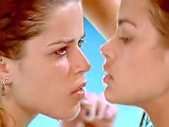 Denise Richards kissing Neve Campbell in a pool