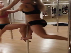 Girls at stripper fitness class spin on the pole