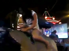Babe rides the bull and reveals the ass and tits