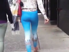 Blue spandex hugs her ass on the city street