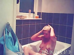 Foxy blonde with perky tits enjoys masterbating in the bathroom