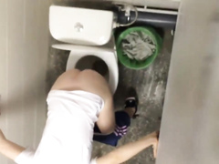Russian girls in winter clothes gets taped while peeing in the street toilet