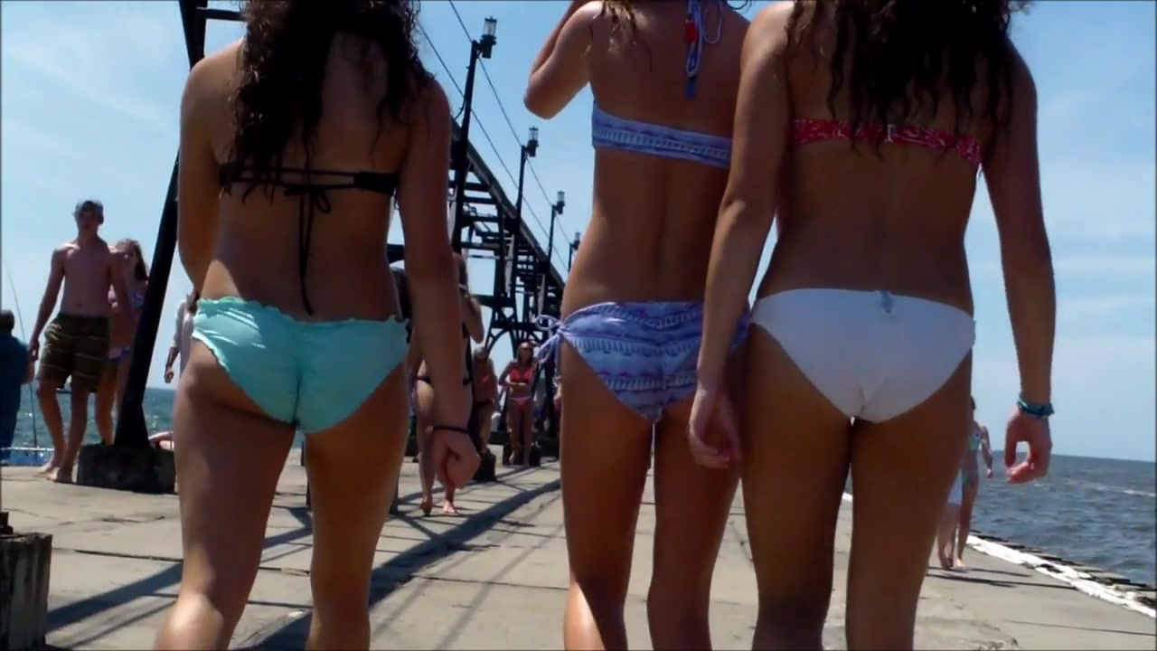 British coed girls on a vacation wear tight bikinis to the beach