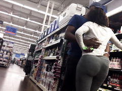 Black lady with a cute butt walks around the supermarket